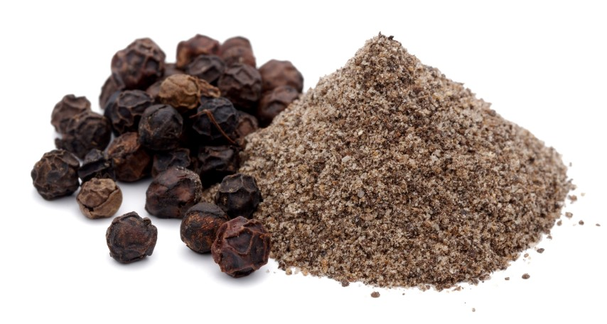 A pile of ground black pepper and Black pepper